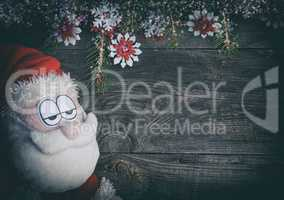 Textile Santa Claus on a gray wood surface