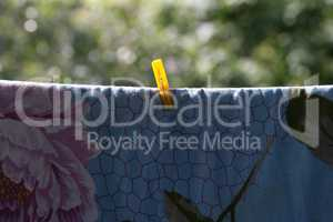 one clothespin on blue bedsheet