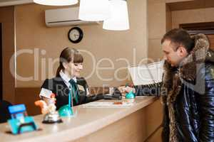 Male guest at hotel reception  during check-in