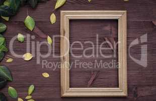 Empty wooden frame on brown wood surface