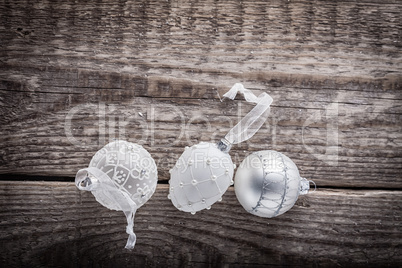 White christmas balls on a wooden background.
