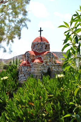Reproduction of a church on a hillock.