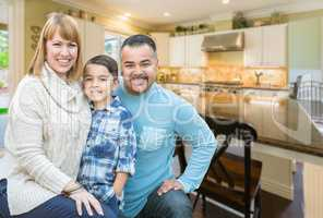 Mixed Race Young Family Inside Kitchen of House