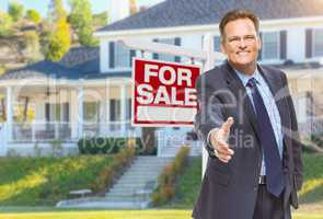 Male Agent Reaching for Hand Shake in Front of House and For Sal