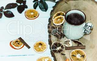 cup of hot tea with steam on a wooden surface