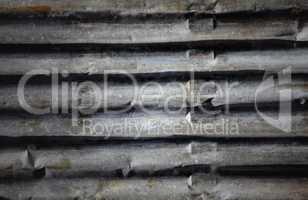 Old corrugated iron fence for background.