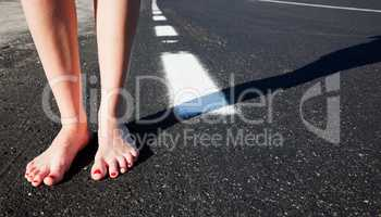 Barefoot girl on the road