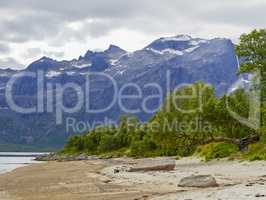 Viking harbor, mountains with snowy peaks fjord