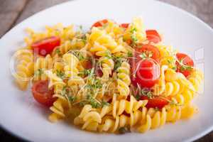 Fussili pasta with watercress and cherry tomatoes.