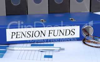 Pension Funds - blue binder in the office