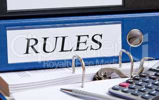 Rules binder on desk in the office