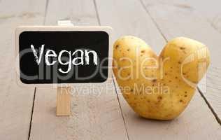 Vegan Chalkboard with heart shaped Potato