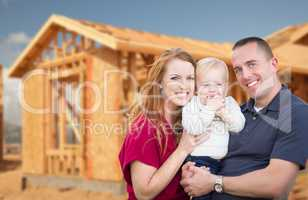 Young Military Family Outside Their New Home Framing