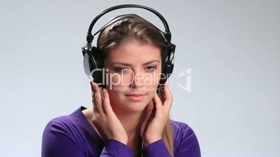 Calm brunette woman enjoying music in headphones