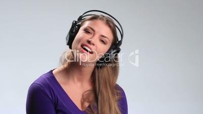 Energy girl with headphones listening to music