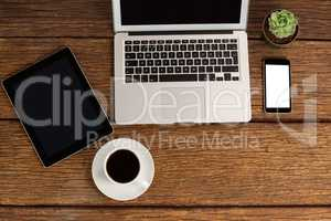 Digital tablet, laptop and smartphone with cup of coffee