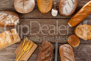 Various bread loaves with scoop of flour and wheat