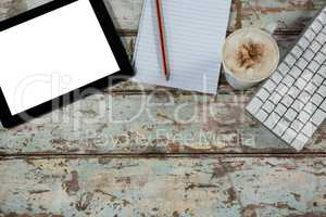 Digital tablet and keyboard with a cup of coffee