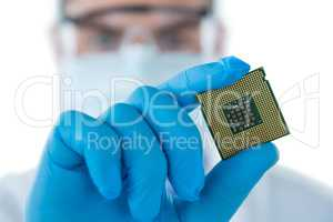 Doctor wearing medical gloves holding electronic chip