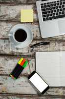 Laptop, smartphone and coffee cup with office accessories