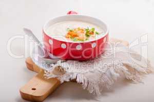 A bowl of creamy cauliflower soup
