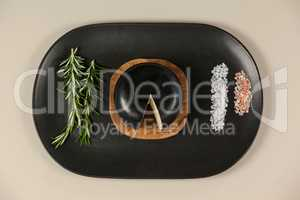 Black cheese with rosemary and salt on serving tray