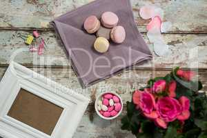 Flower vase, macaroons, candy and picture frame