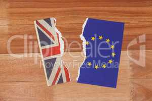 Half torn union jack and european union paper flag