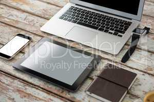 Laptop with smartwatch, smartphone, digital tablet and organiser