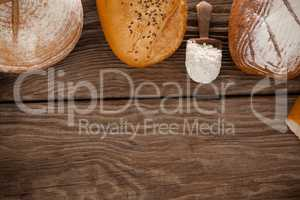 Various bread loaves with scoop of flour