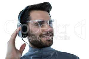 Man in protective glasses listening to headphones
