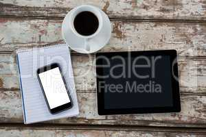Digital tablet with smartphone and cup of coffee