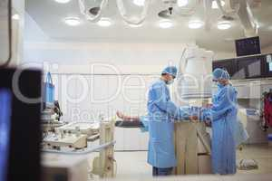 Surgeons examining patient in operation theater