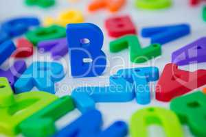 B alphabet standing between toy alphabet