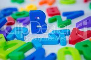 B alphabet standing between toy alphabet