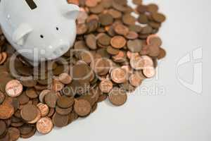 Piggy bank with stack of coins