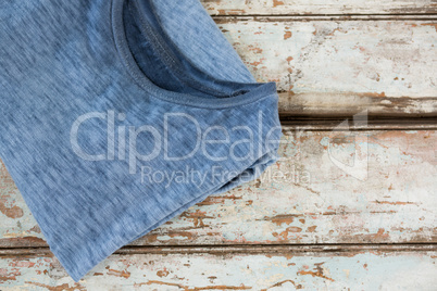 T-shirt on wooden plank