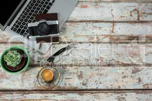 Laptop, camera and diary with coffee cup