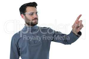 Man wearing protective eyewear pretending to touch an invisible object