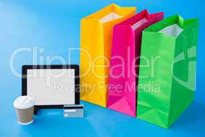 Colorful shopping bags and credit card with digital tablet