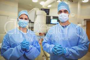 Portrait of surgeons standing in operation theater