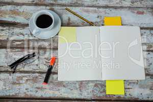 Diary and coffee cup with office accessories