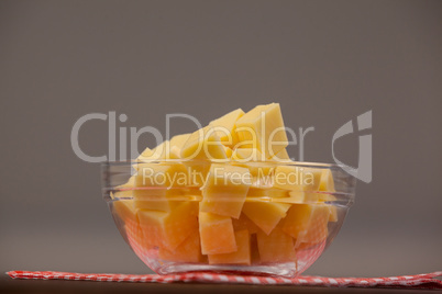 Cheese cubes in bowl on cloth napkin