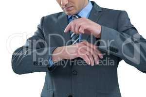 Businessman pretending to use a wrist watch