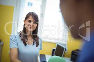 Female patient interacting with doctor during visit