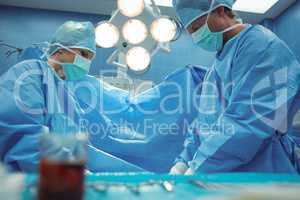 Team of surgeons performing operation in operation theater