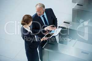 Businessman talking with colleague at turnstile gate