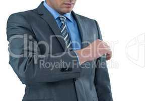 Businessman pretending to check wrist watch