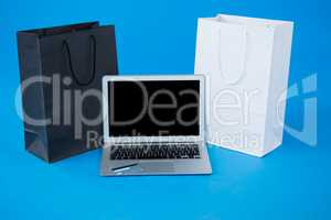 Shopping bags and credit card with laptop