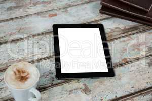 Digital tablet with cup of coffee